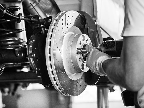 fitting-brake-pads-bw-min.jpg