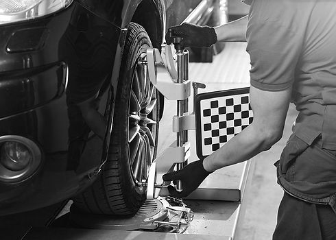 man-fitting-wheel-alignment-bw-min.jpg