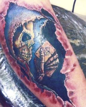 skull gambling bein tattoo.jpg