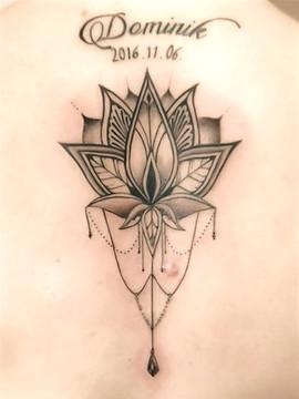 Lotus flower back tattoo.jpg