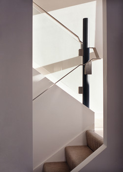 glass balustrade with white walls