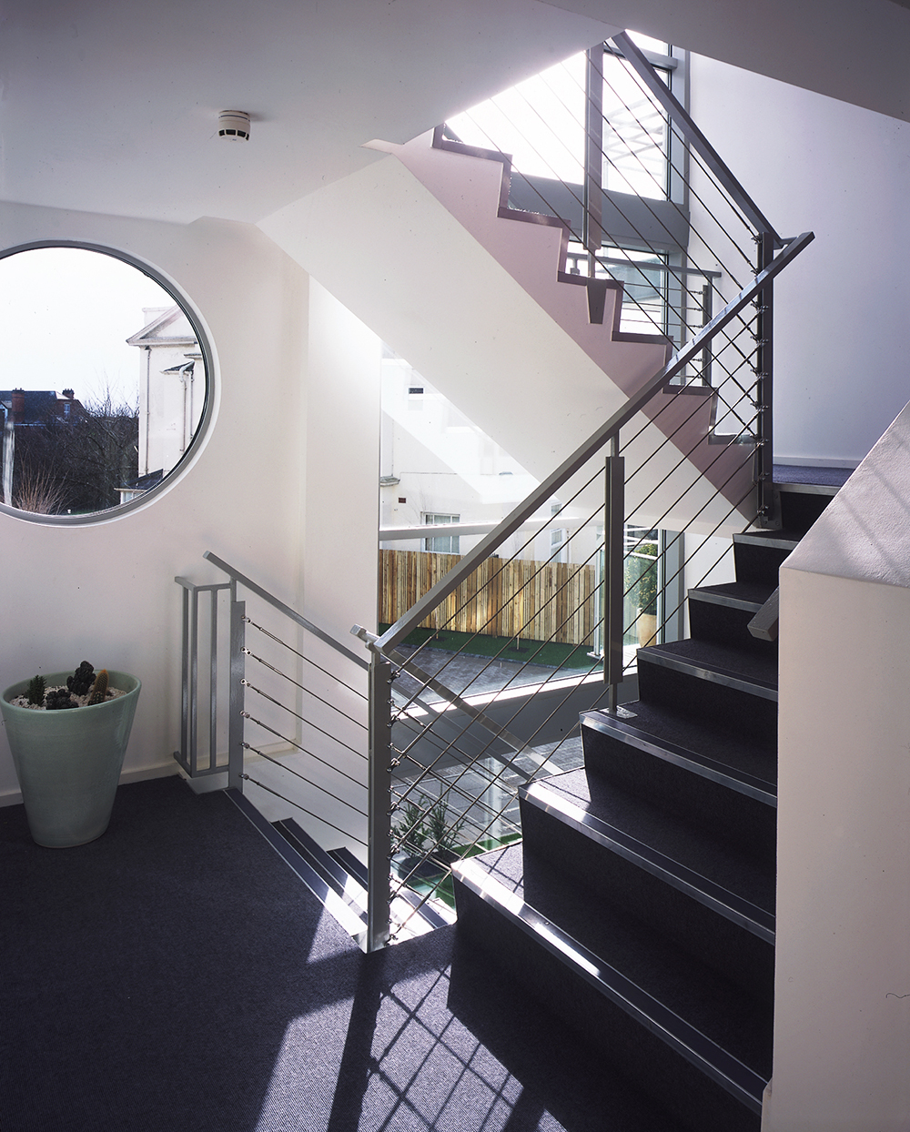 Modern staircase with round window
