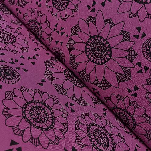 Bio-Jersey mit Blumenmuster in lila, auf der Rolle