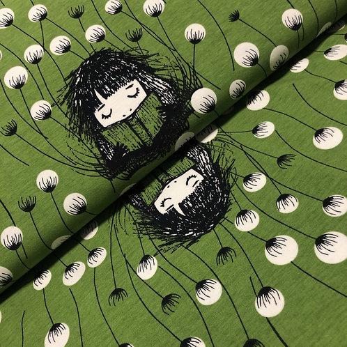 Grüner Bio-Jersey-Stoff mit Bücherwurm, auf der Rolle