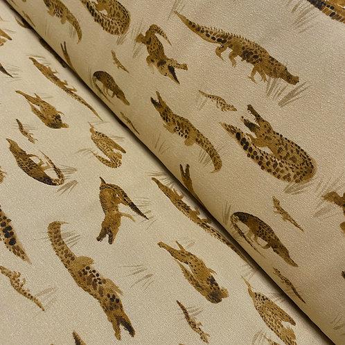 Lehmfarbener Jersey mit Krokodilen, auf der Rolle