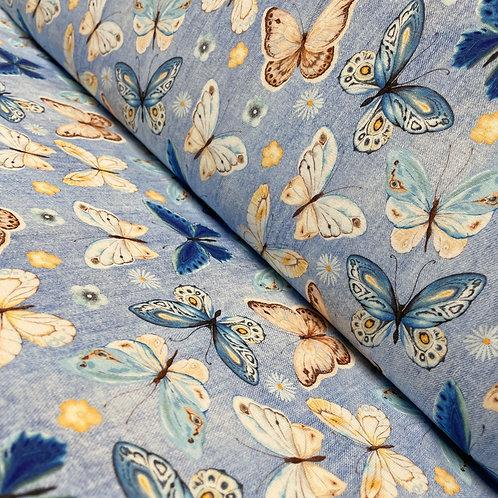 Jeansjersey in hellblau mit Schmetterlingen, auf der Rolle