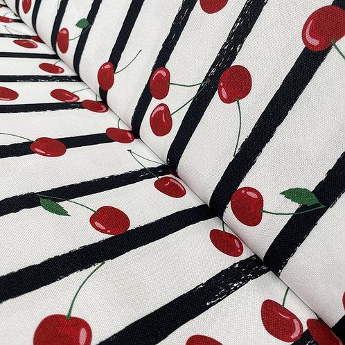 Canvas mit schwarzen Streifen und roten Kirschen, auf der Rolle