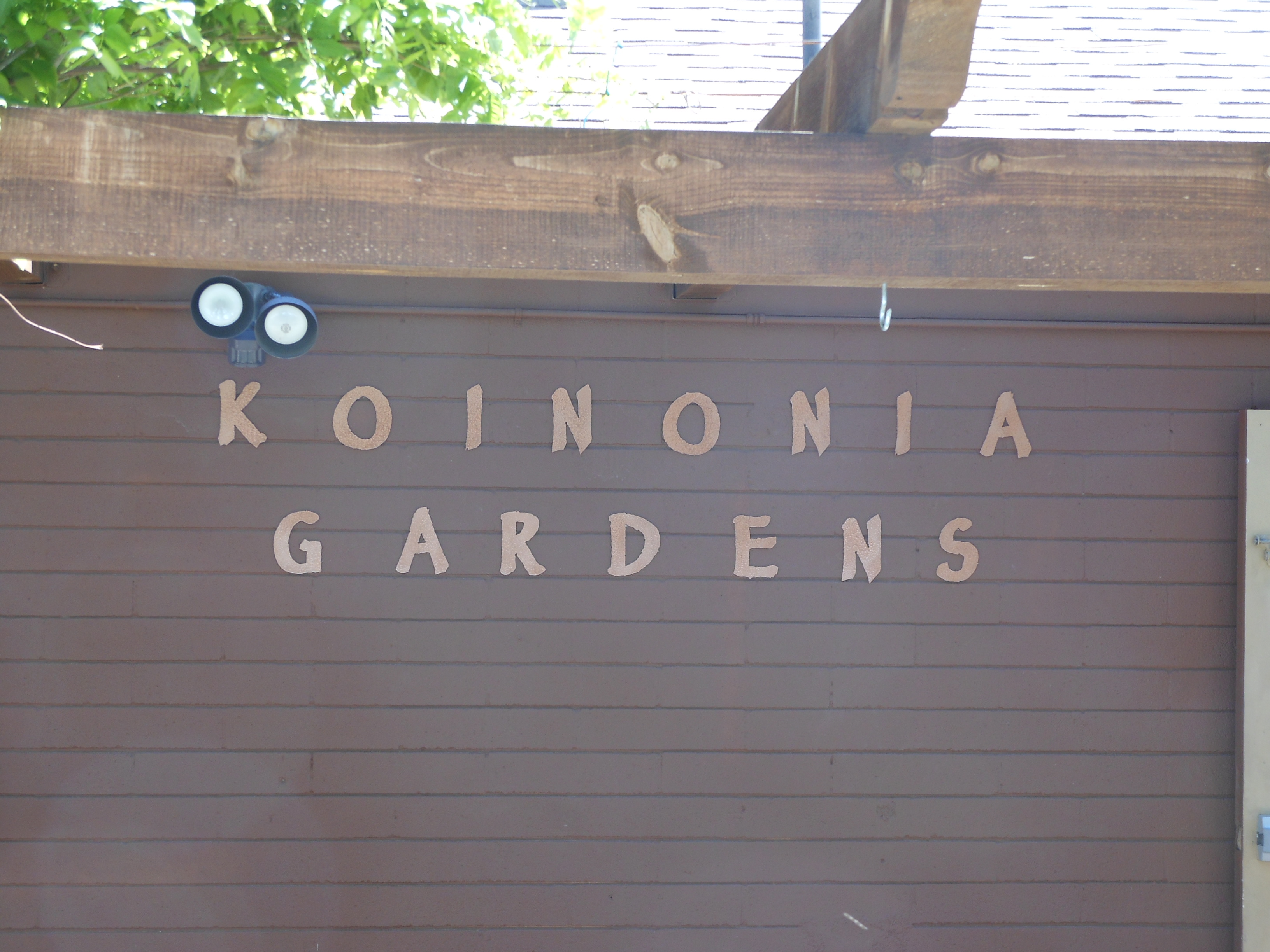 closeup of Koinonia gardens lettering