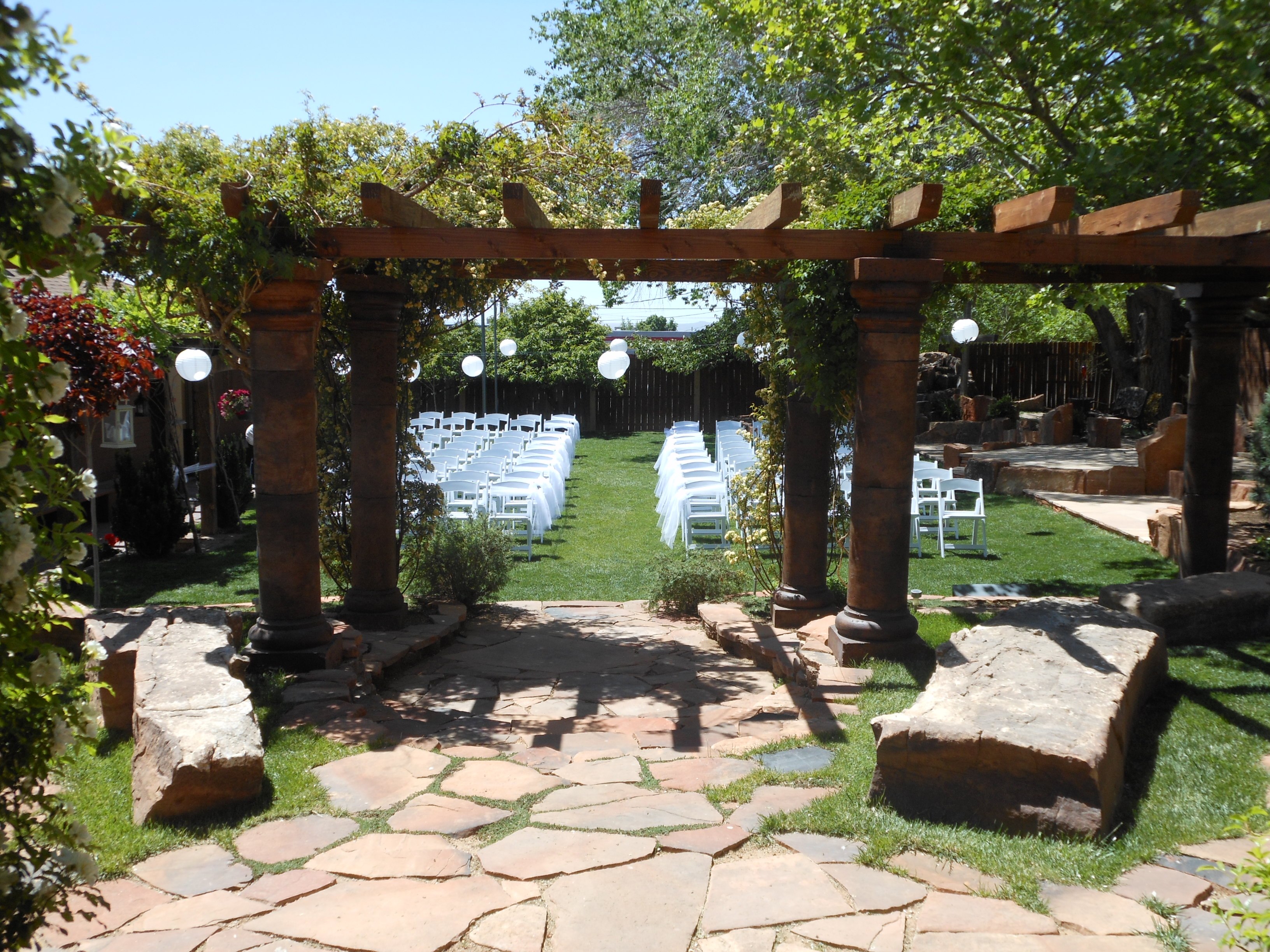 chairs and arbor facing West