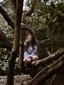 girl connecting to tree.jpg