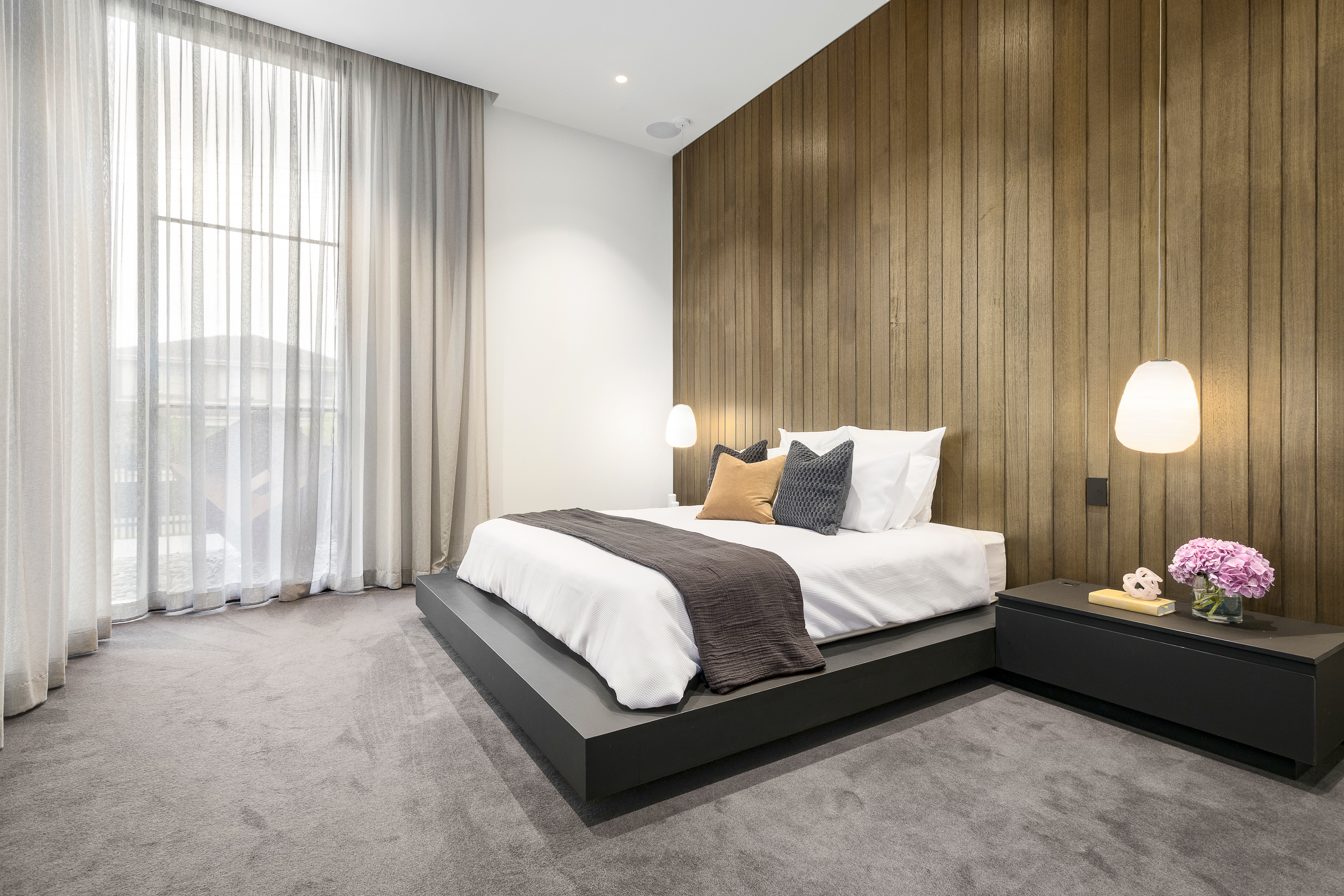 bedroom with wood paneling