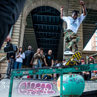A man grinds a rail during Harold Hunter day at LES skatepark.