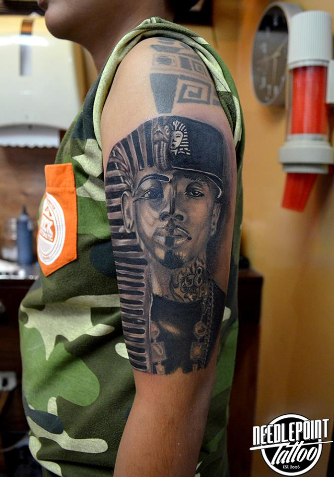 Tyga and pharaoh portrait tattoo