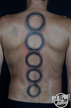 Pointillism circle tattoo