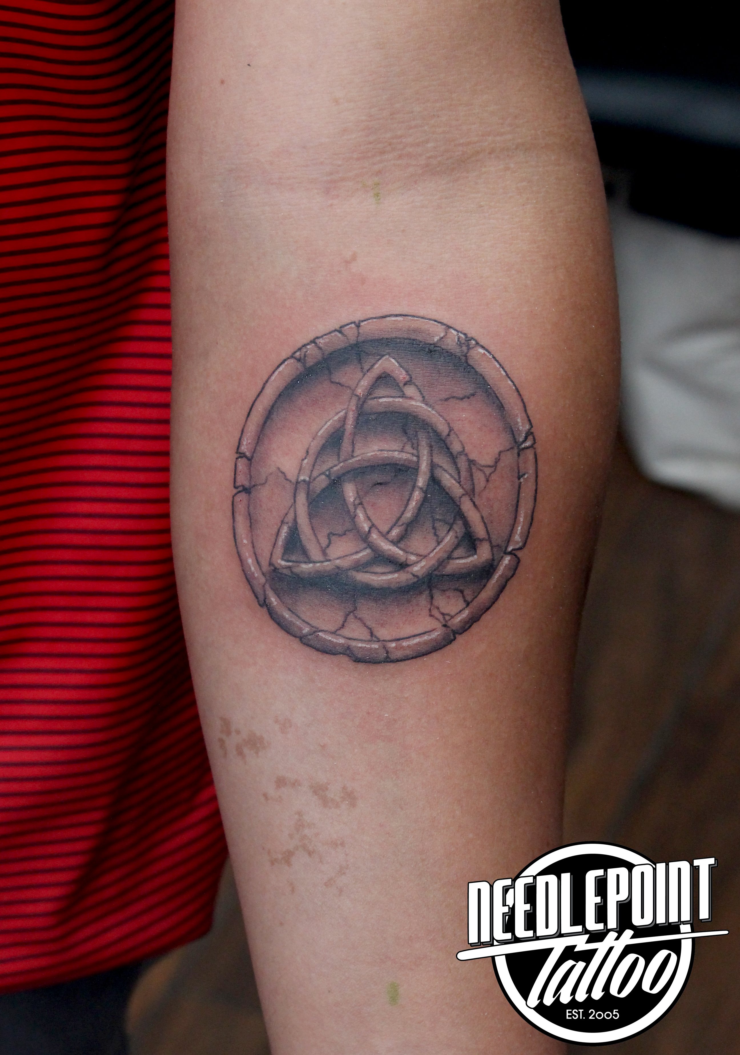 black and grey triquetra
