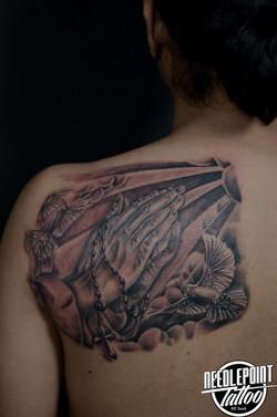 Custom praying hand and dove tattoo