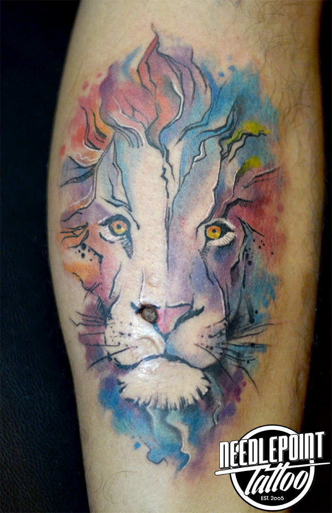 watercolor style lion tattoo