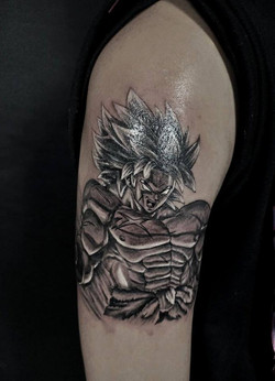 Black and gray broly tattoo