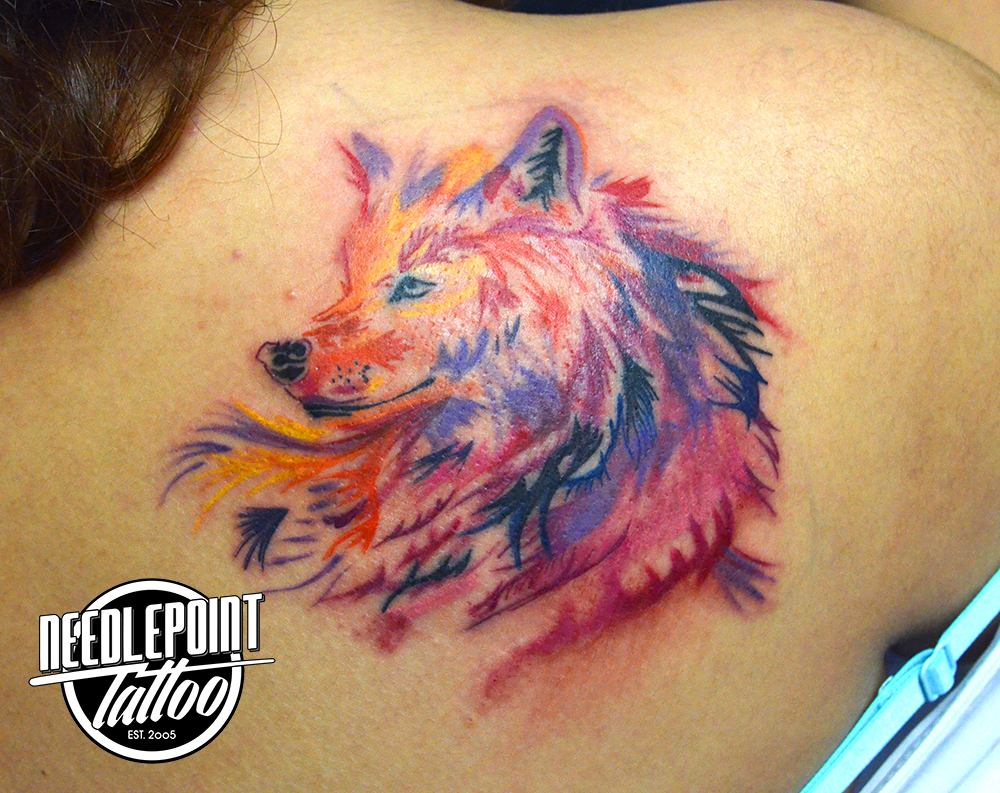 Watercolor style wolf tattoo