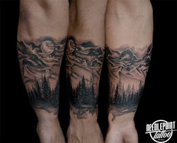 Black and grey Mountain and Moon tat