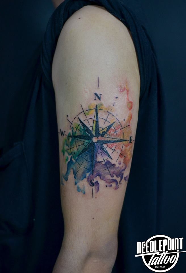 Compass with water color tattoo