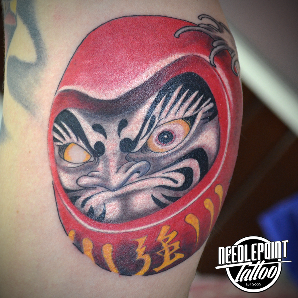Daruma colored tattoo