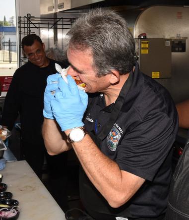 Mayor Davis Bites Into Our Signature Wild & Wreckless Burger!