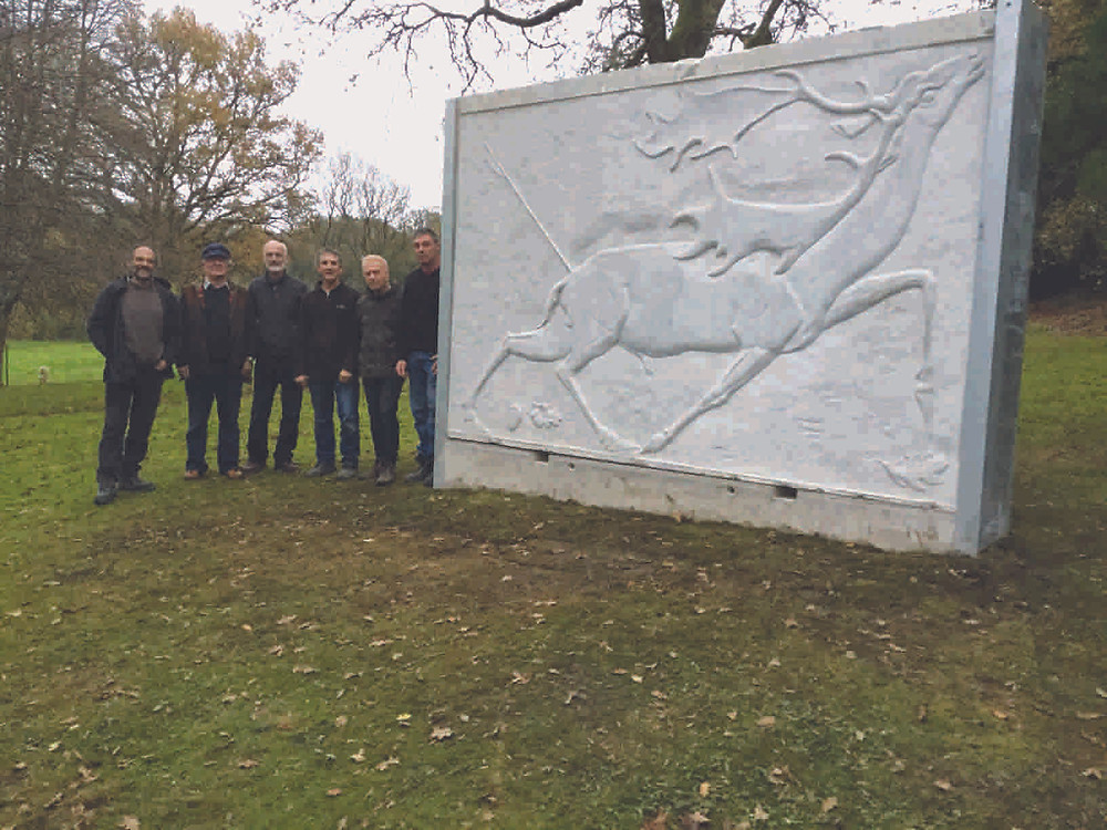 White Buck carving by Sven Berlin in its new home and the team that moved it in 2015.