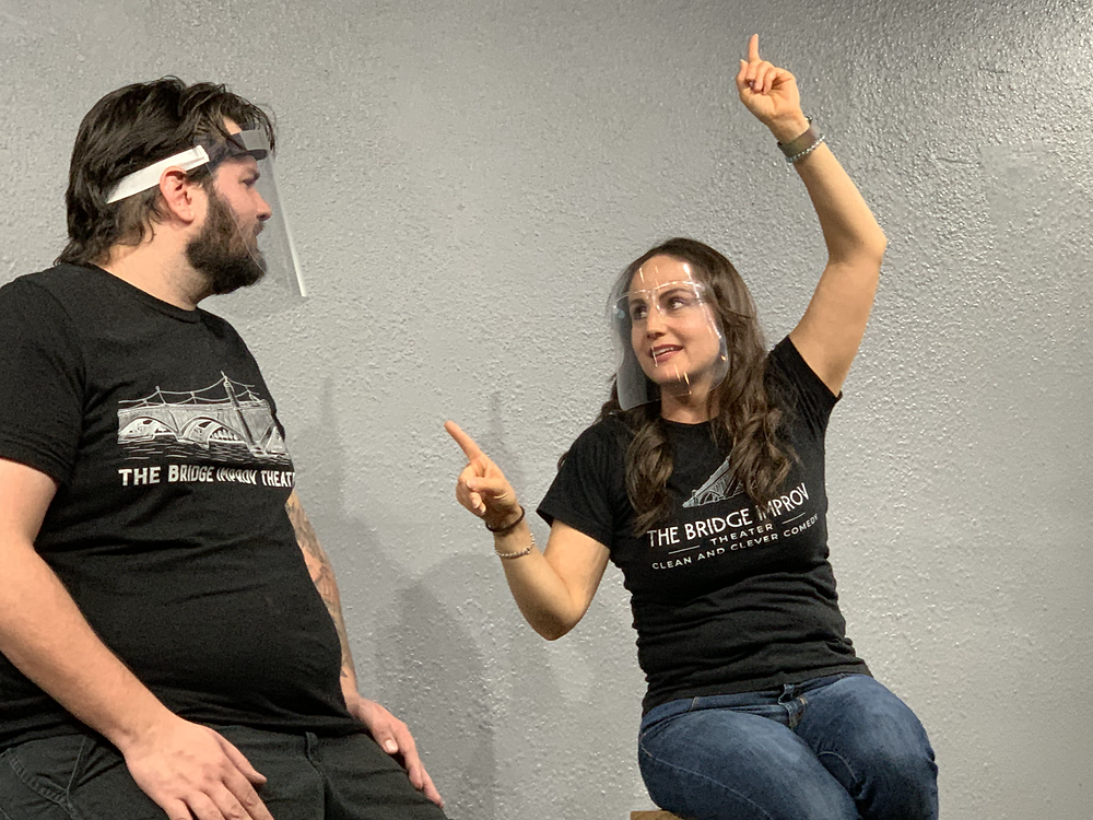 Sarah Johnson and David Raftery performing and improv comedy scene at The Bridge Improv Theater