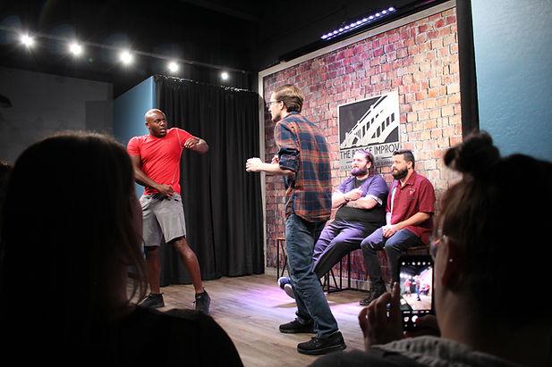 nate nicholas david eric performing improv comedy scene at the bridge improv theater.JPG