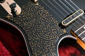 Superlight Heartbreaker in Black, NOS (aged), RVT Pickups, Open Neck Pickup Cover, Custom Gold Fracture Pickguard, Gold Hardware, Rosewood Fingerboard, Clay Dots, Blackface Original with Golden Silkscreen Logo.