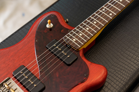 Stinger in Transparent Cherry, NOS (aged), RVT P90 Pickups, Red Tortoise Pickguard (Buffed), Lightweight Stinger Half Bridge with Brass Saddles, Madagascar Rosewood Fingerboard, Clay Dots, Natural Headstock with Macmull inlay.