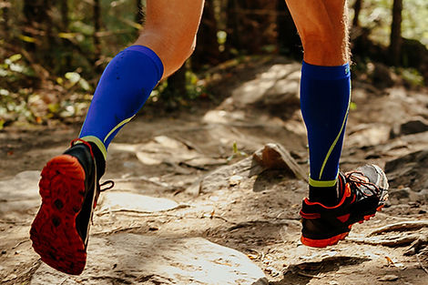 Photo of trail runner wearing compression socks. Sole Train can help you pick some out!