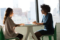 women talking at table 21910887703_eef22