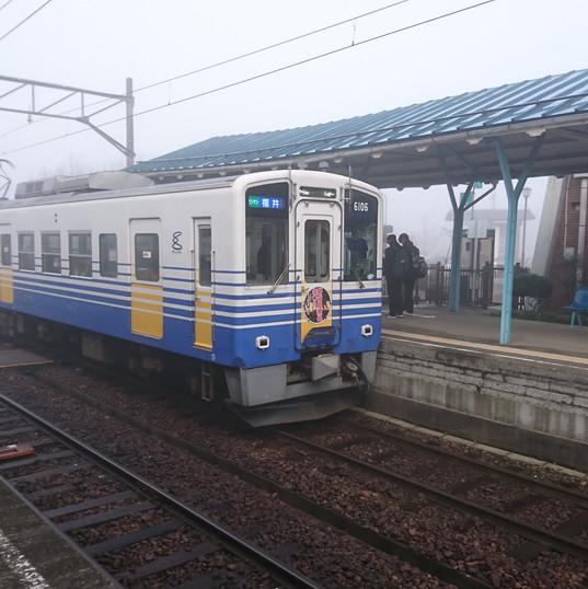 a local train comes in the mist