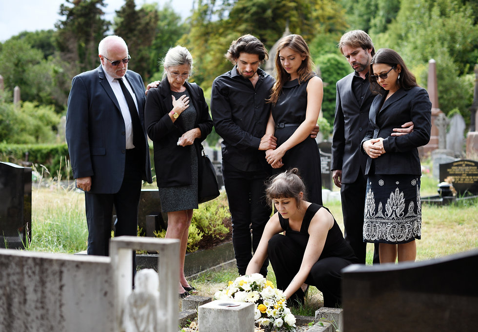 Family laying flowers on the grave.jpg