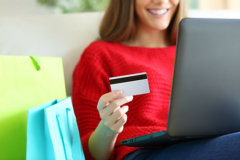 Girl buying on line with credit card.jpg