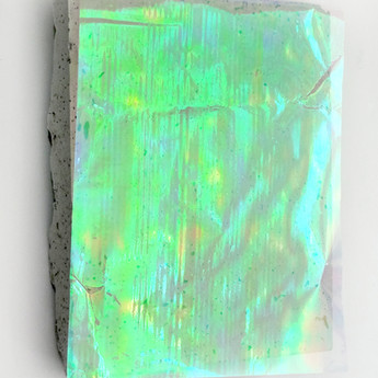 Sem título, 2017 Celofane nacarado sobre cimento 28x22x3cm