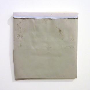 Sem título, 2016 Tinta serigráfica e parafina sobre cimento. 40x39x2cm