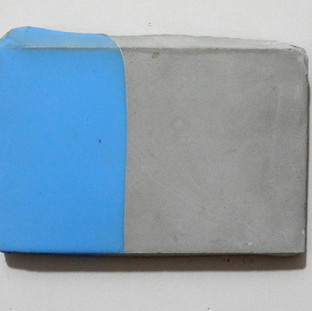 Sem  título, 2016 Borracha de silicone sobre cimento. 11x14x1cm