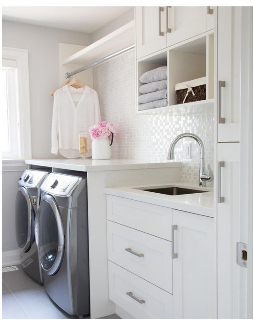 white laundry room with hanging space