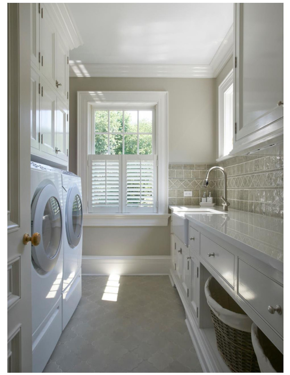 tan laundry room with sink
