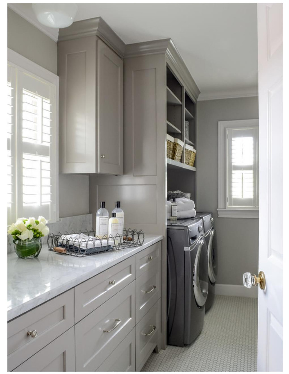 gray laundry room cabinetry