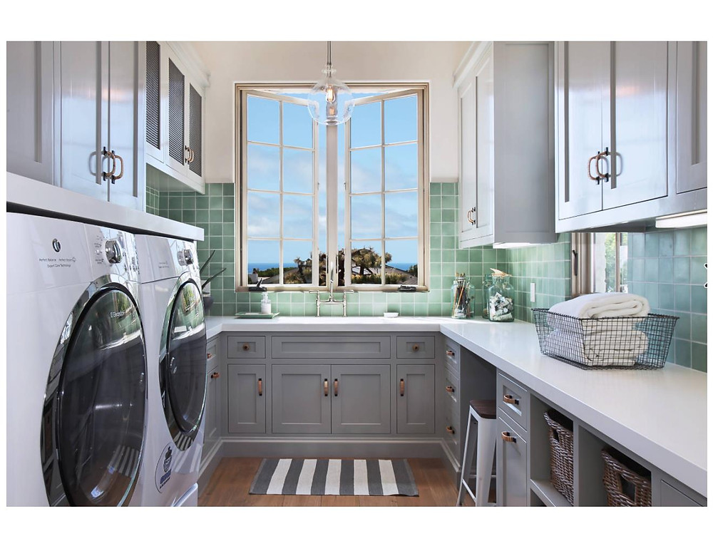 gray laundry room teal tile