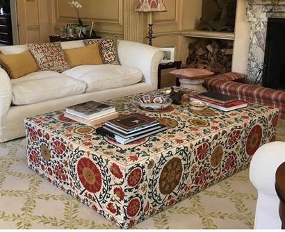 Large ottoman with silk embroidered suzani