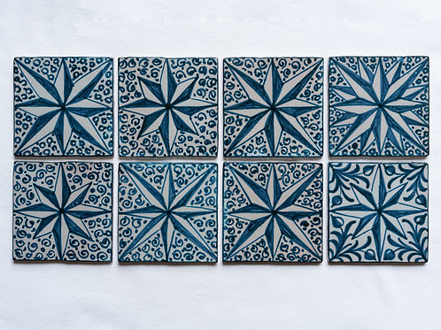 Set of 8 hand painted tiles with dark blue star motifs