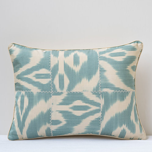 Single acqua cream patchwork ikat cushion with silk reverse