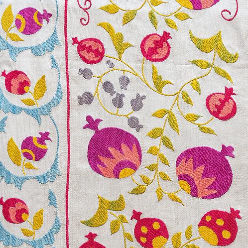 Silk hand embroidered brightly coloured pomegranates suzani