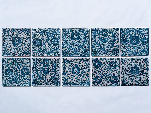 Set of 10 hand painted tiles with dark blue pomegranate motifs