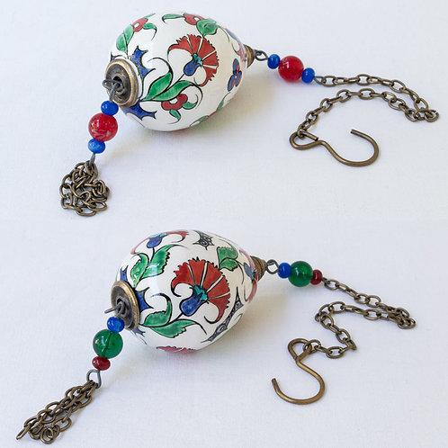 (F) Set of 2 hanging hand painted ceramic votive eggs